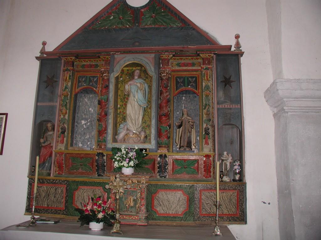 Retábulo das santas. á esquerda, a Santa Bárbora.